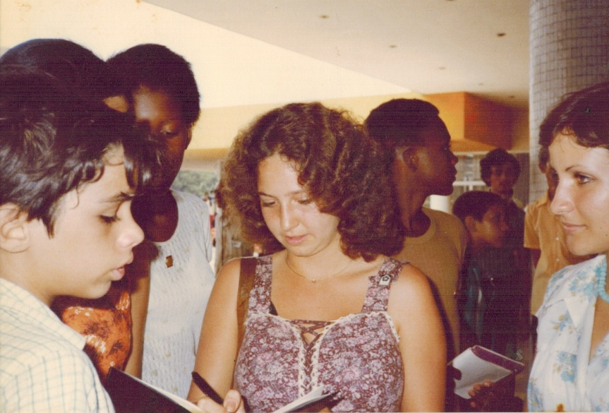 Valerie Landau signing autographs at the World Youth Festival in Havana 1978 as Marta Martinez looks on.